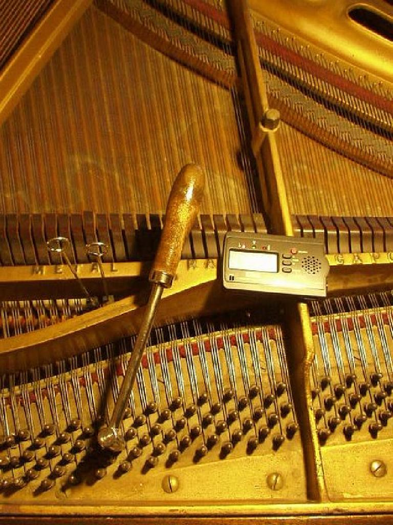 The first thing I did was tune the piano.  Each key was flat by about 40 Hz!