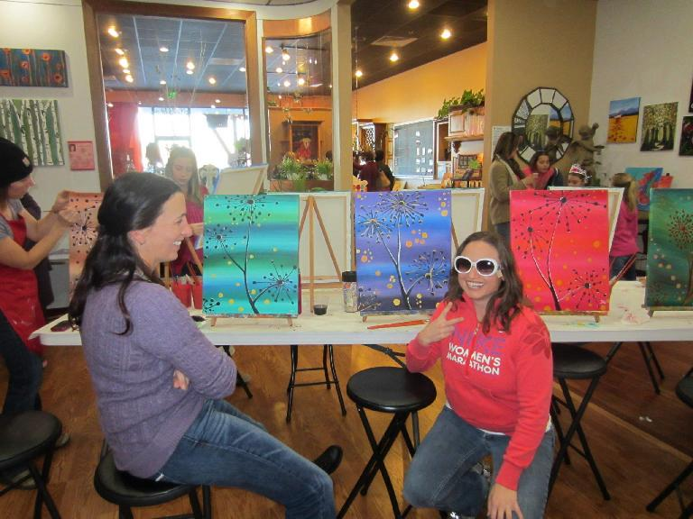 Lisa finishes up her painting while Tori looks at Raquel and her big glasses.