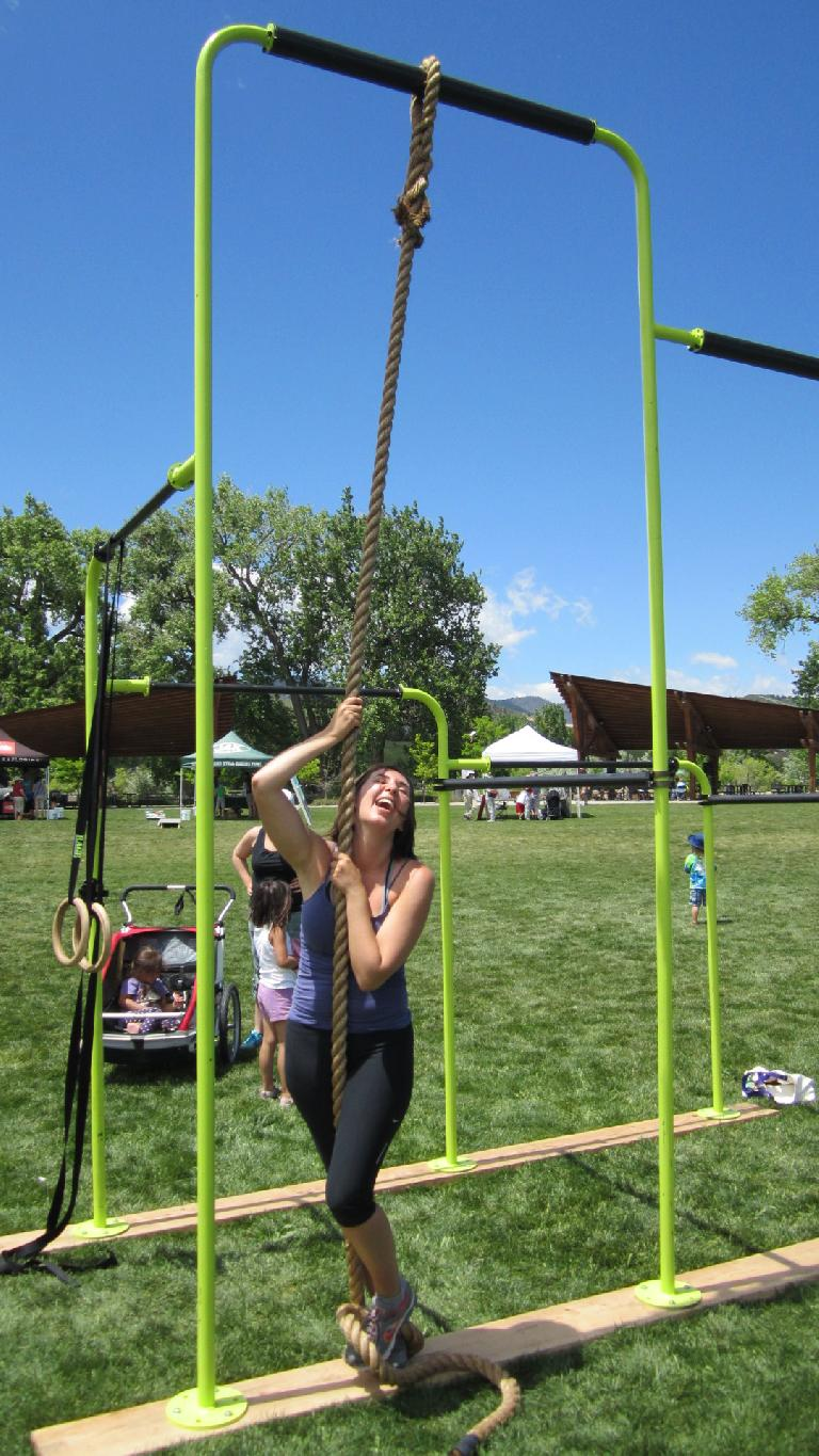 Diana trying to ascend a rope the Wild Gym Company set up.