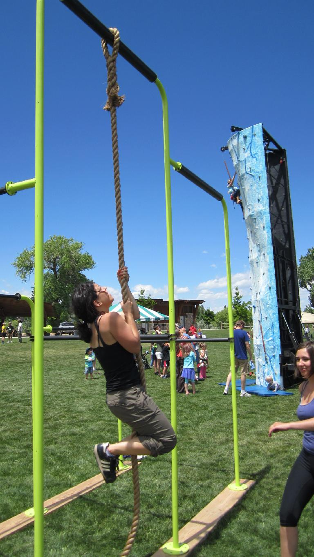 Lauren going up the rope.