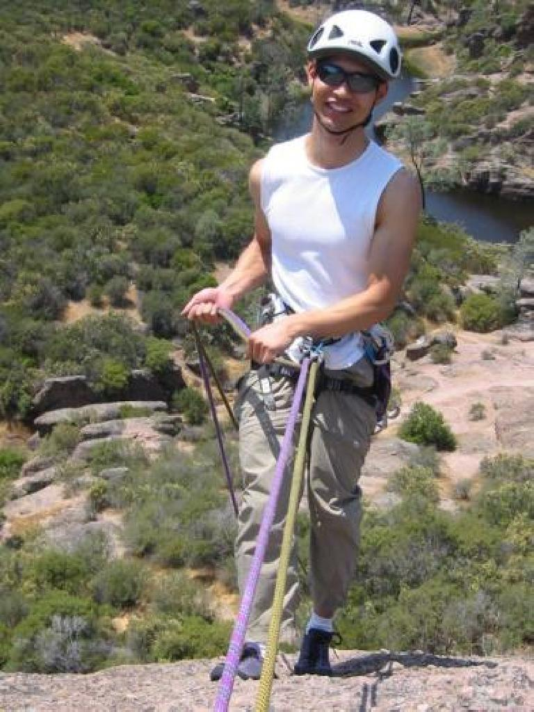 Felix, on rapel.  If he looks happy here, it is because he really likes rapelling! Photo: Loren Cheng.
