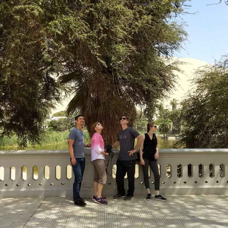 Felix, Mel, Matthew, and Teresa at the Huacachina Lagoon in Ica, Peru.