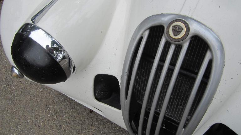 Front end of a vintage Jaguar XK.