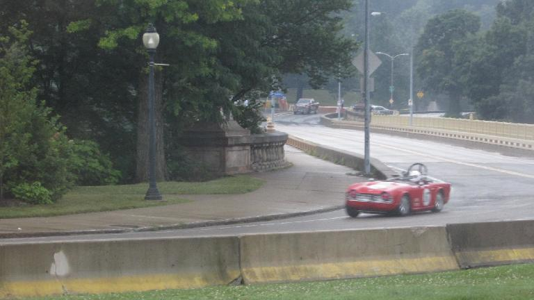 The Triumph TR250 doing a qualification lap outside of Kristina and Juergen's wedding at the Phipps Conservatory, in the rain! (July 19, 2014)
