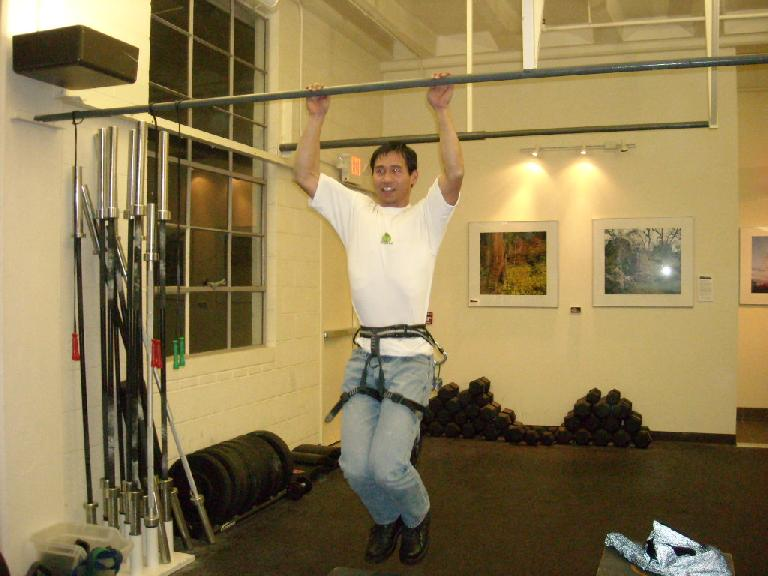 Felix Wong doing weighted pull-ups.