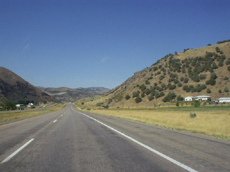 The forest land 50 miles to the east of Pocatello gave way to barren foothills upon the approach to the town.