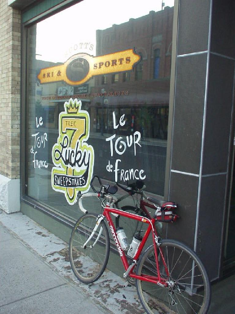 "My Cannondale in front of a bike shop and this ""Le Tour de France"" sign after a 30-mile bike ride."