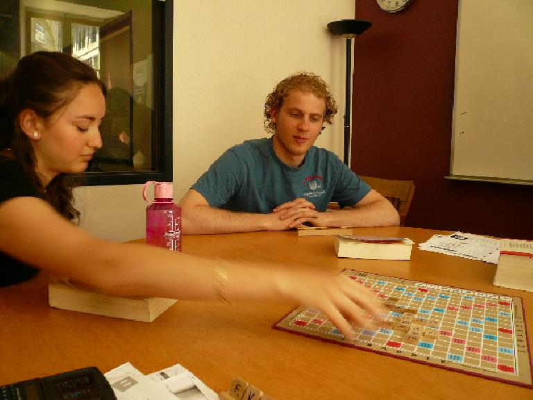 Anna makes her move in French Scrabble as Jurian looks on. (May 14, 2008)