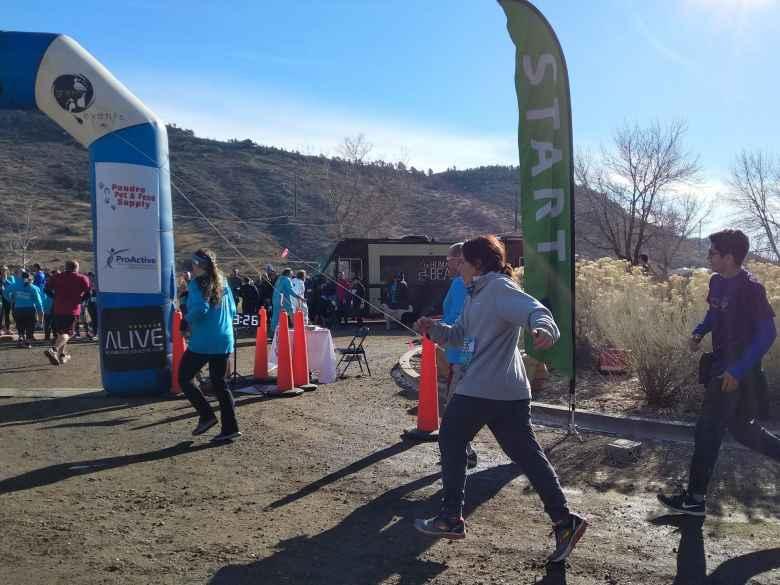 Jennifer about to cross the finish line of the 2019 Polar Bear 5k Run.
