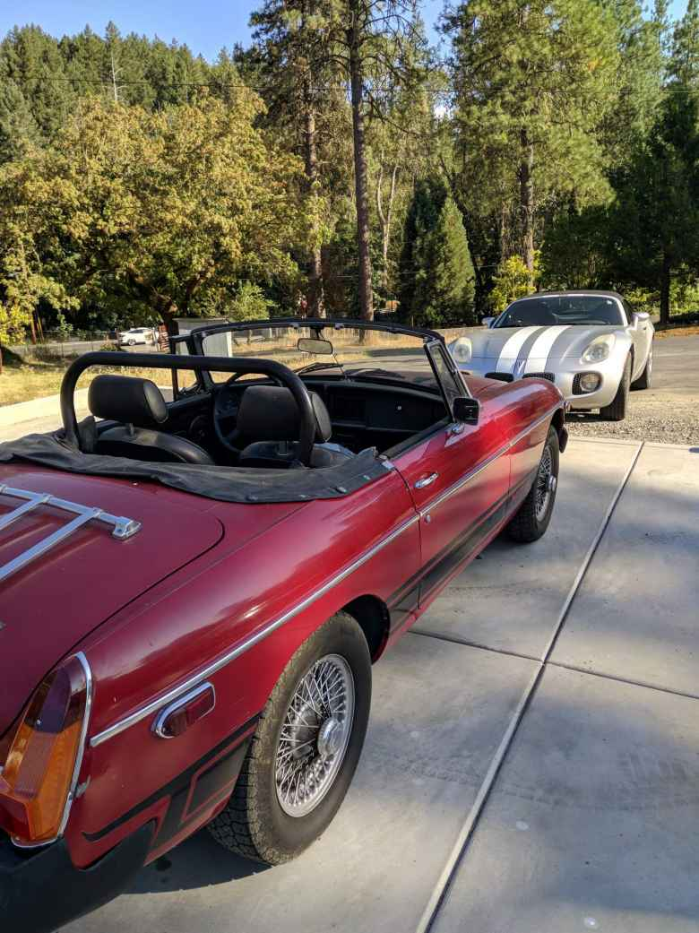 A red 1975 MGB with a silver Pontiac Solstice GXP.
