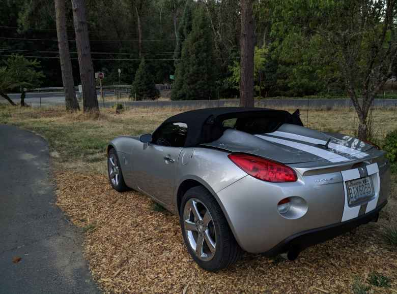 Popping the trunk of a Pontiac Solstice will release the buttresses of the convertible top.