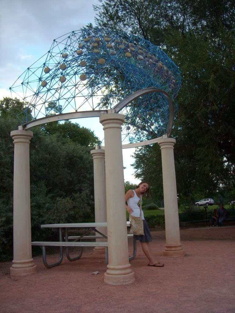 Leah underneath some City Park artwork that represented the trajectory of the sun over Fort Collins.