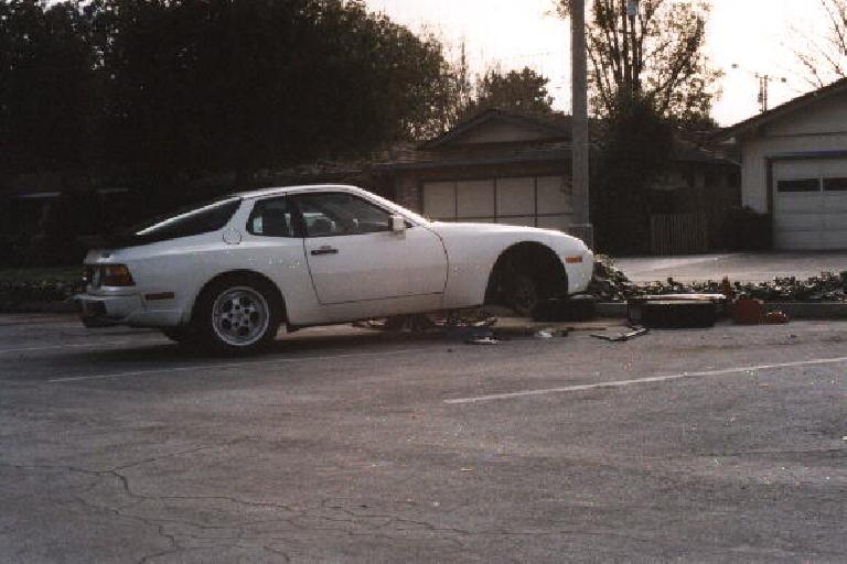 white Porsche 944 Turbo with front on jackstands