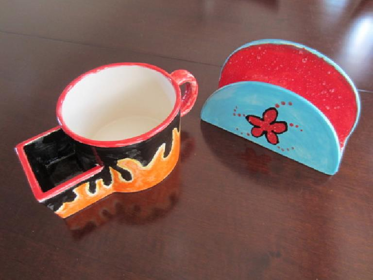 "My ""flames"" tea cup and Raquel's napkin holder after glazing."