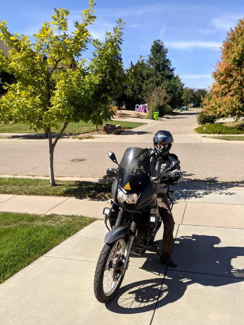 Alex arrives at my house on his black Kawasaki KLR 650.