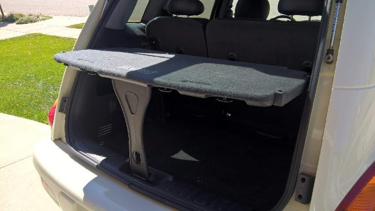 """The PT Cruiser's parcel shelf in its tailgating, """"table"""" position."""