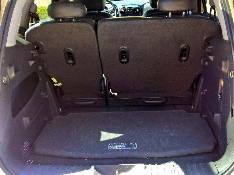 The PT Cruiser's parcel shelf stowed away on the floor of the cargo area.