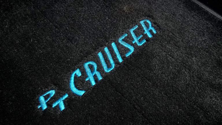 black PT Cruiser floor mat, blue letters