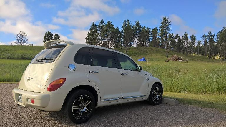 Cool Vanilla 2005 Chrysler PT Cruiser, blue tent, pine trees, Chadron State Park.