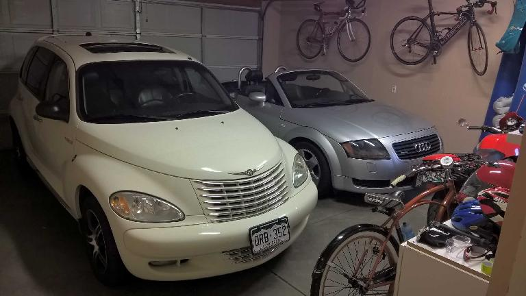 Cool Vanilla 2005 PT Cruiser GT, silver 2001 Audi TT Roadster Quattro, bicycles, red Buell Blast motorcycle, garage