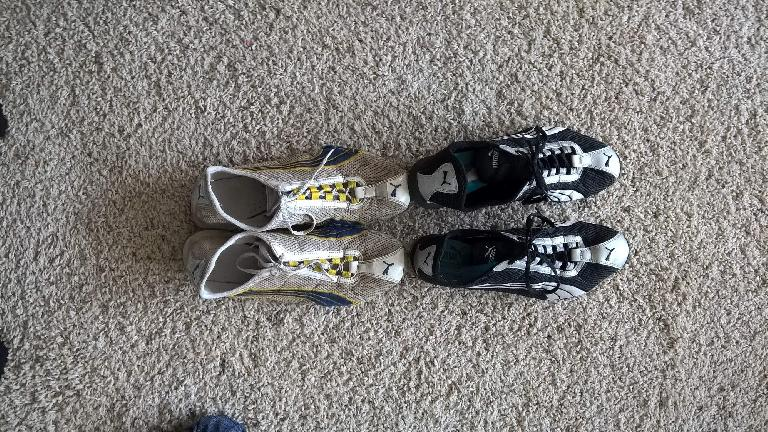 Overhead view of white, yellow and blue 2008 Puma H-Street shoes after 1174 miles.