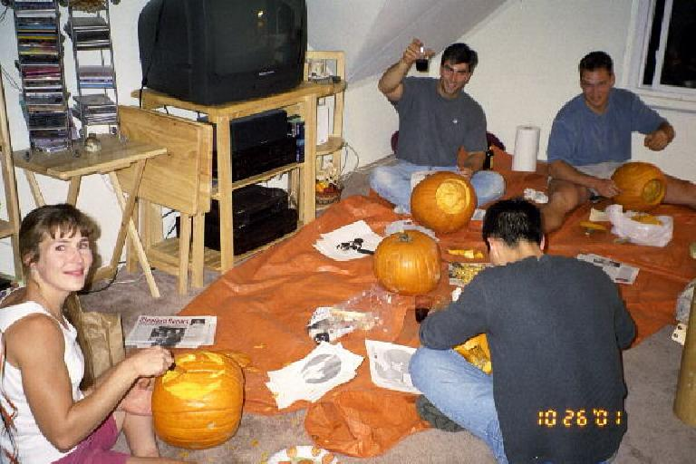Pumpkin carving at Sharon's.  Clockwise from left: Sharon, Rob, Ralf, and Felix. (Photo courtesy of Katie, who did not take a photo of herself.)