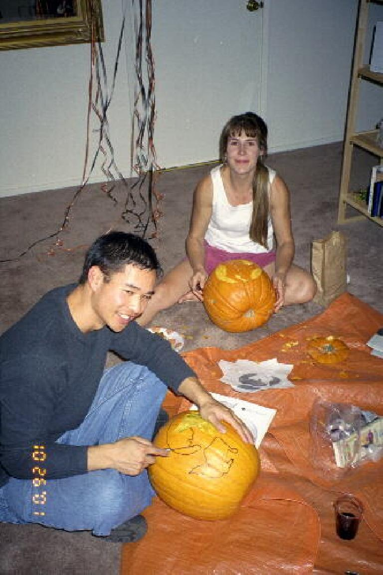 Felix Wong and Sharon working away at their pumpkins.  (Photo courtesy of Katie.)