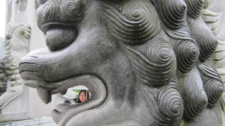 Woman in our tour group framed by a lion's mouth.
