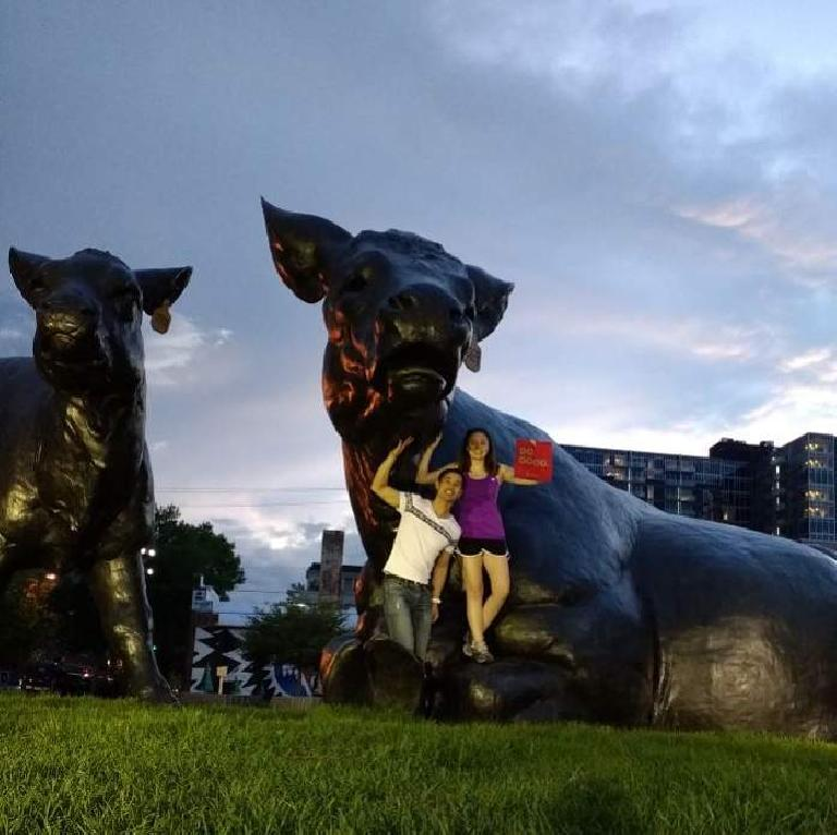 Felix and Maureen in front of the Denver Art Museum's cows.