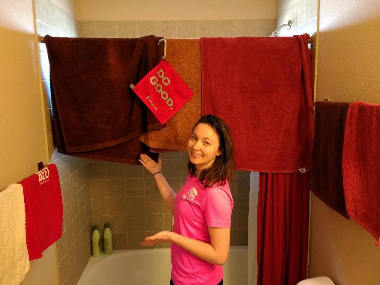 Maureen hang drying a load of laundry.