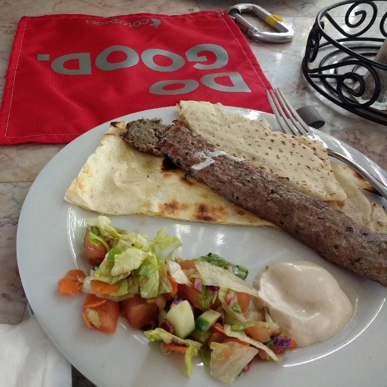 Eating kafta kabobs Fetafeat restaurant in Fort Collins.