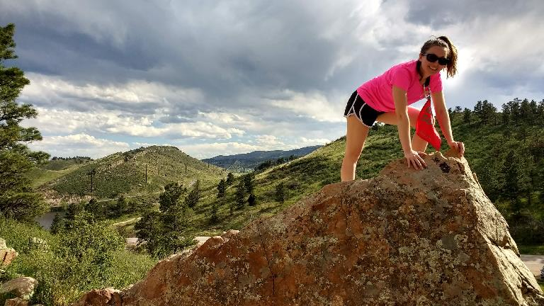 Maureen doing a bouldering problem at Piano Ridge in Fort Collins.