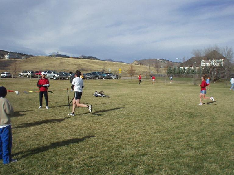 X-country runners coming into the finishing chute at the Rattlesnake Rumble in Fort Collins.