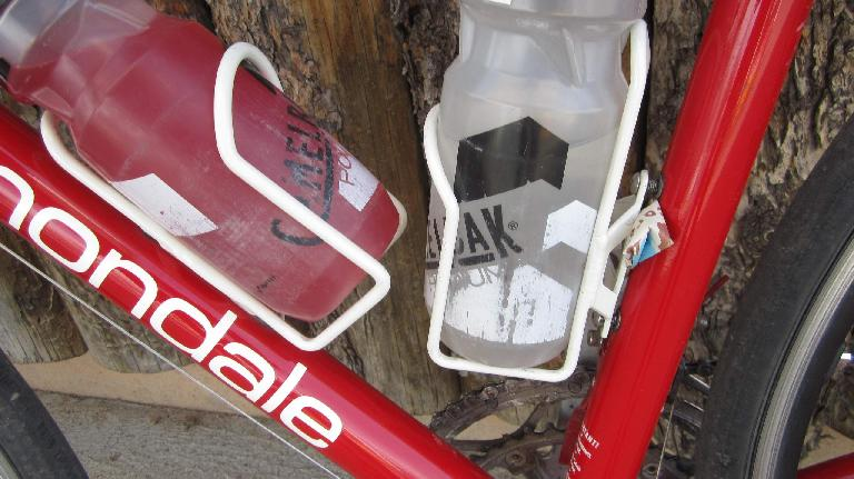 White water bottle cage, red bicycle, Clif Bar wrapper shim