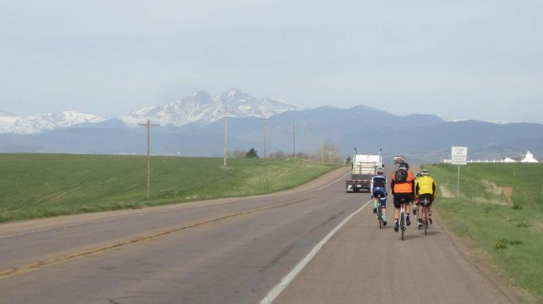 [Mile 10] Riding through Berthoud towards Longs Peak behind the second lead pack.