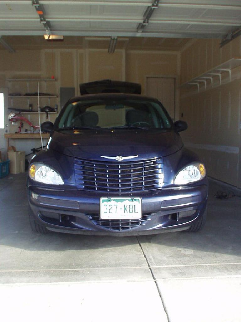 "The ""face"" of the PT Cruiser sports a glorious large radiator grill of yore."
