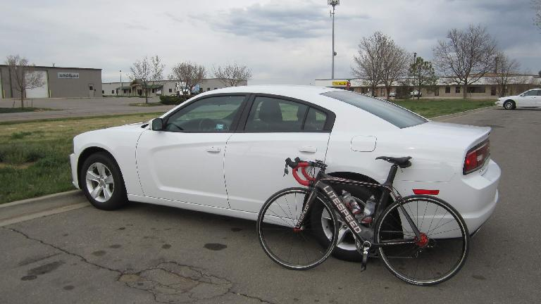 The 2014 Dodge Charger is so huge that by simply folding down the rear seats I could slide the Super Bike in without removing either of the wheels. (April 26, 2014)