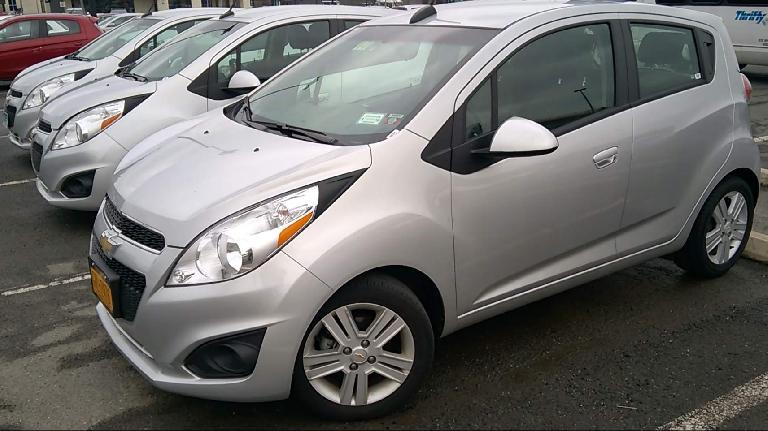 silver 2015 Chevy Spark rental cars