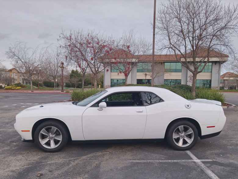 Side view of a white 2019 Dodge Challenger SXT.