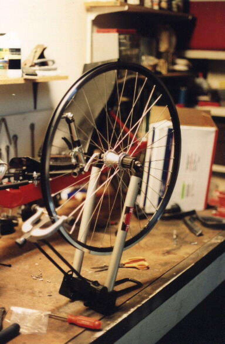 building 26 inch wheel, Velocity rims, on Minoura truing stand