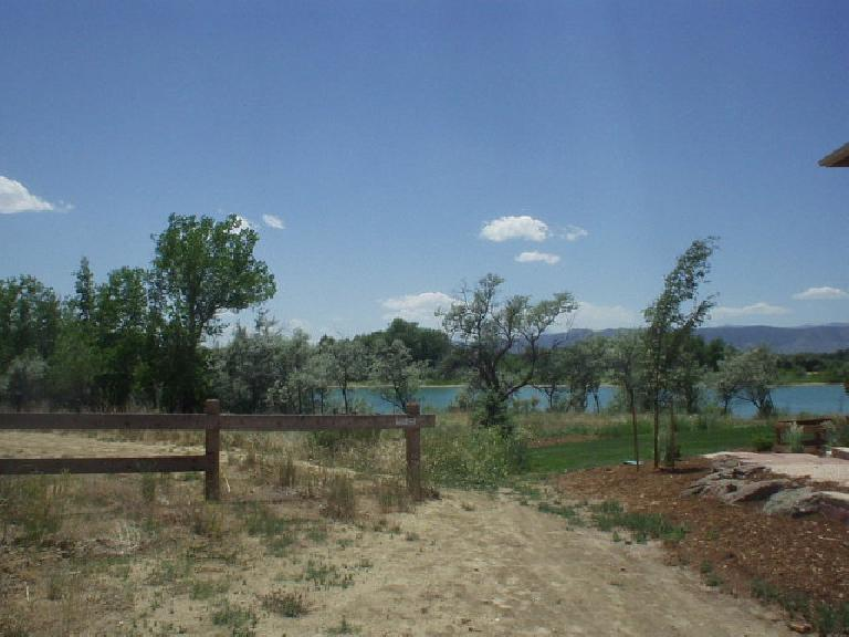 A trail leading down to trees by Richards Lake in north Fort Collins.