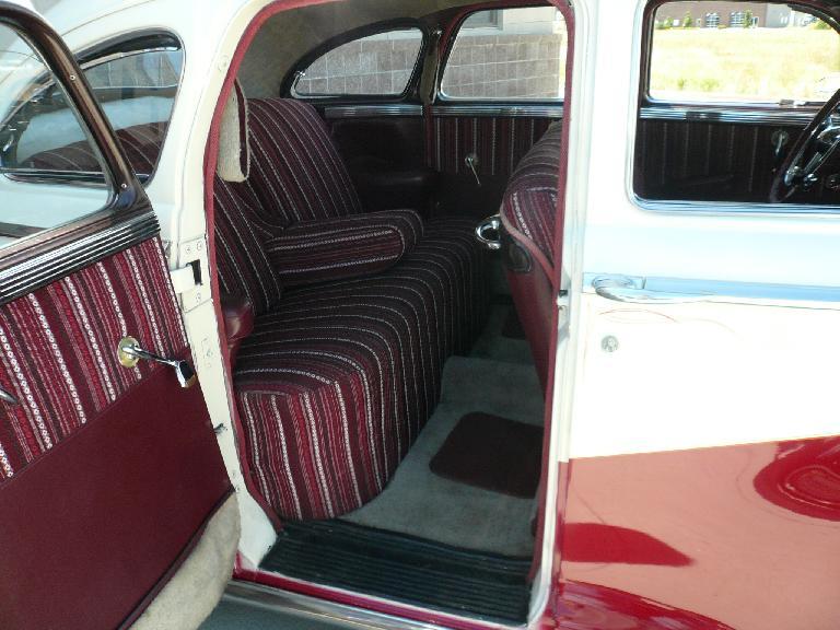 The back seat of a Chrysler sedan.