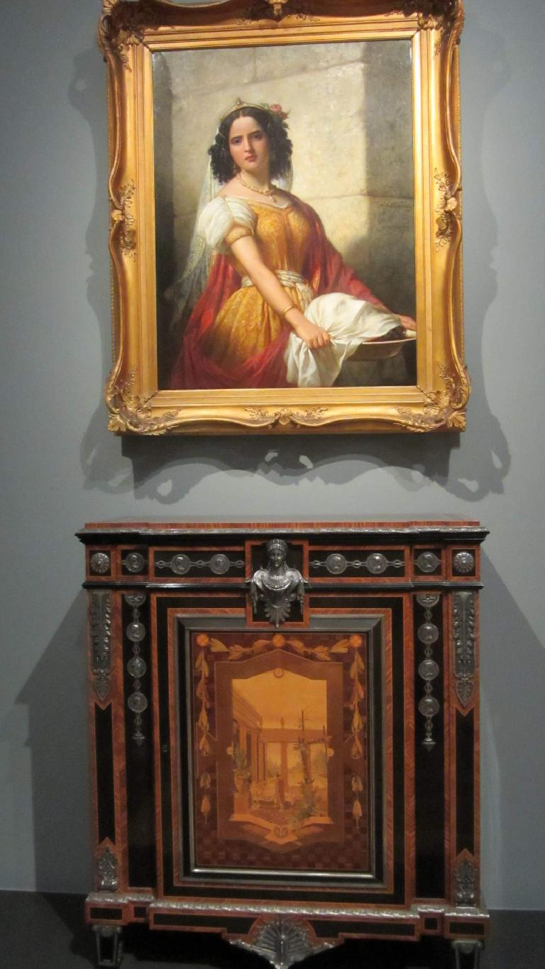 Portrait of a woman over a cabinet.
