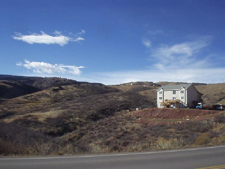 A solitary home southwest of the Horsetooth Mountains.