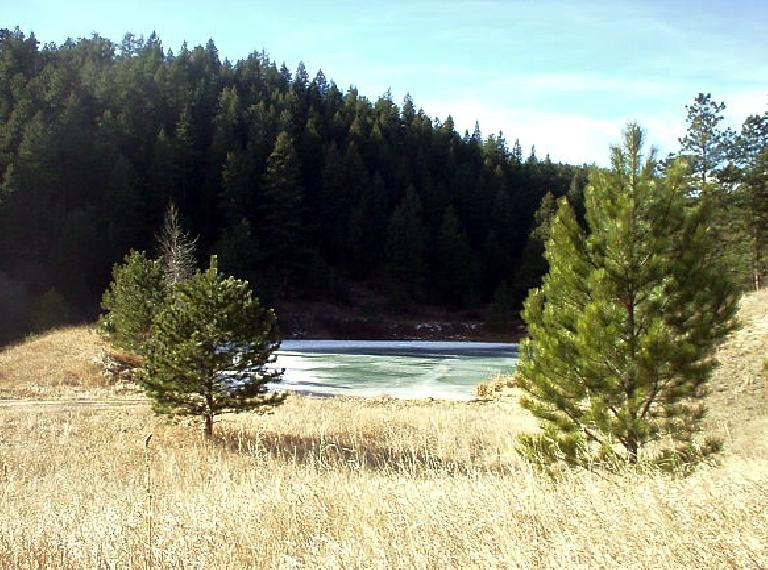 This is a frozen pond among the pine.  The scenery reminded me of the Cascade Lakes region west of Bend, Oregon.