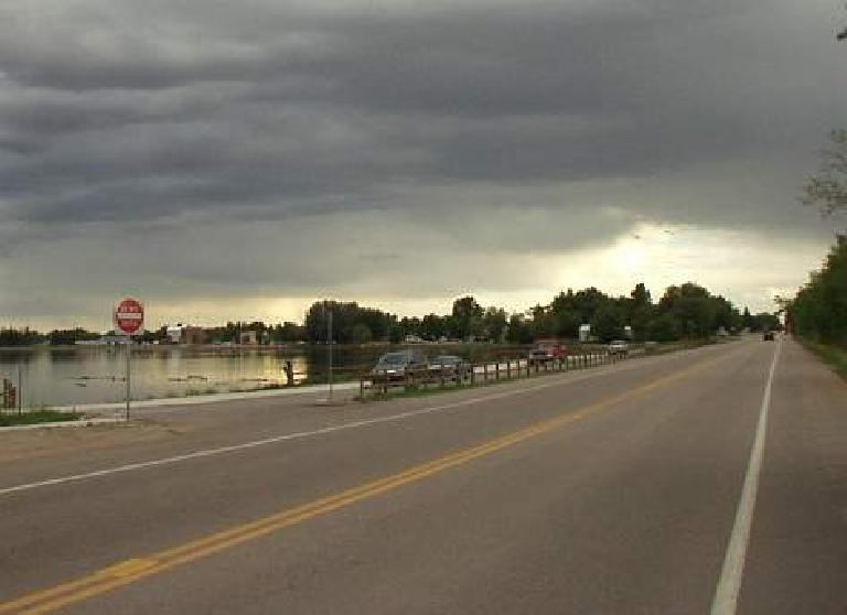 [Mile 205, 7:07pm] Going by a lake in Windsor.  Rain would start falling in another 15 minutes and I'd only get back to the Louisville finish 4 hours later, 2 hours after night had befallen.