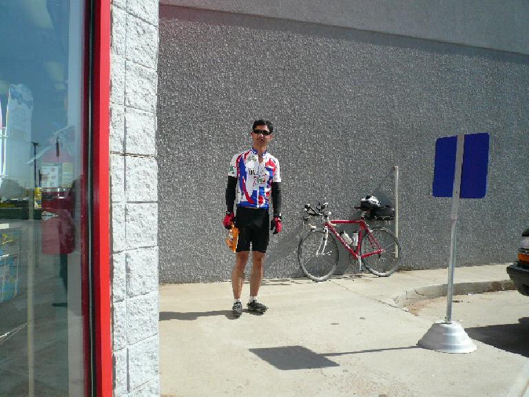 [Mile 308, 9:37 a.m.] Felix Wong with a bag of Doritos in Kersey.  By this time it was getting pretty hot (high 80s).
