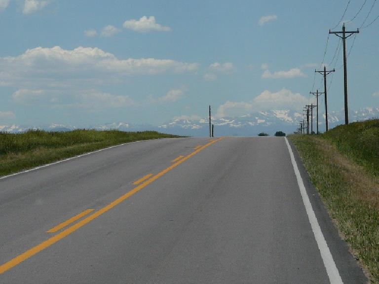[Mile 349, 12:40 p.m.] The top of this climb was rewarded by the sight of the snow-capped Rockies.