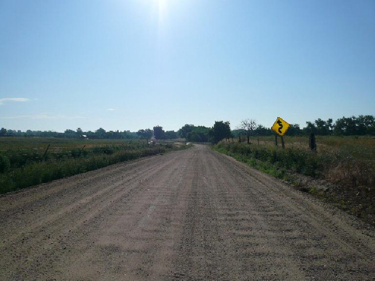[Mile 294, 8:13 a.m.] Washboard dirt road: turns out this was NOT on route!  Too bad I rode over it for about a mile!
