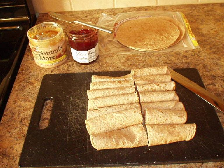 [Day before the brevet] Making a bunch of tortilla rollups with peanut butter and strawberry preserves.  Also made oatmeal raisin cookies and packed some fig bars. (June 15, 2007)
